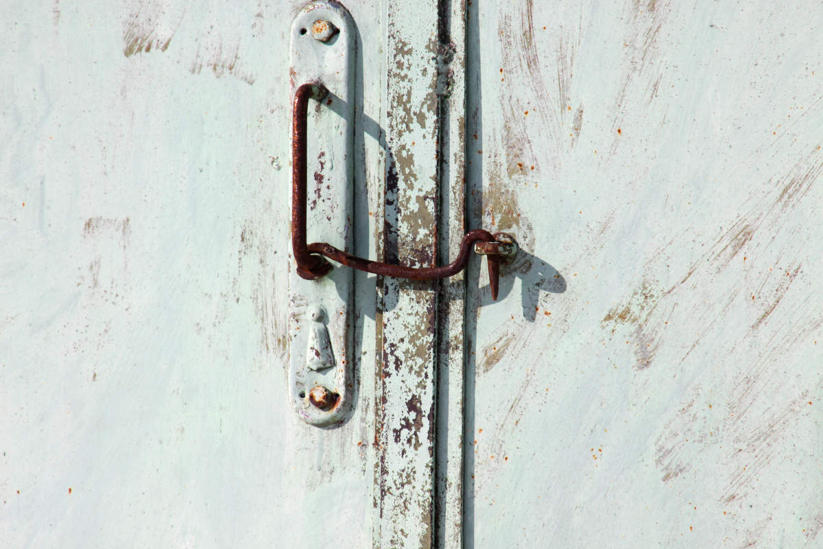 old metal pen with union hook on the gate.