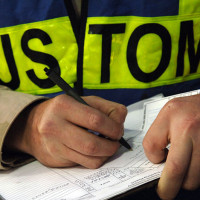 800px-US_Navy_061209-N-8148A-067_A_customs_border_clearance_agent_assigned_to_Navy_Customs_Battalion_Romeo_keeps_record_of_each_inspection