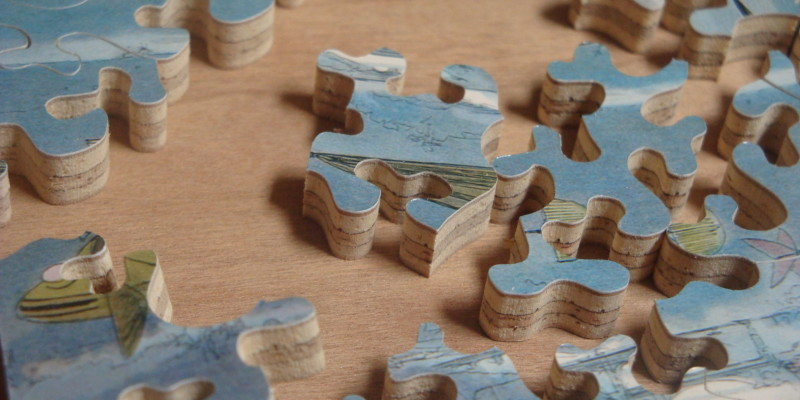 Close_up_of_Hand_Cut_Jigsaw_Puzzle