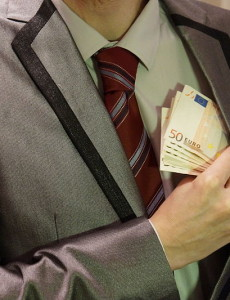 800px-4_-_corruption_-_man_in_suit_-_euro_banknotes_hidden_in_left_jacket_inside_pocket_-_royalty_free,_without_copyright,_public_domain_photo_image
