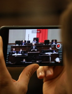 polish-parliament-sejm-kaczynski-right-phone